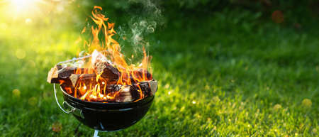 Barbecue Grill with Fire on Open Air. Fire Flame Standard-Bild