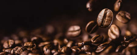 Brown Roasted Coffee Beans Closeup On Dark Background