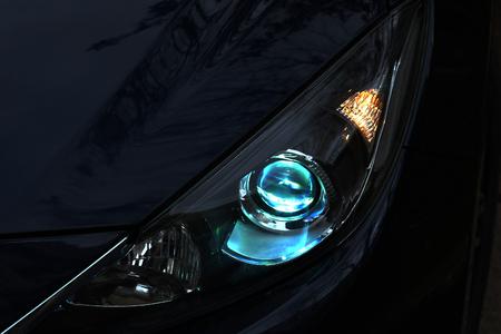 alight: Alight neon car headlight on the dark background.