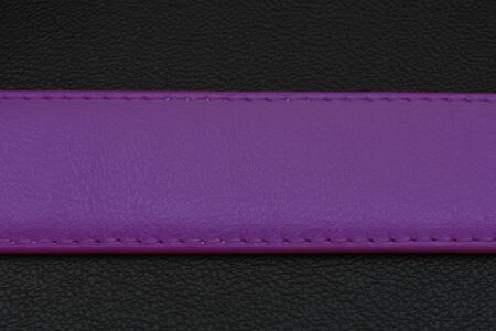 center position: Fiolet stripe on black background. Belt from skin or leather. Belt with fiolet color. Center position on background. Place for your text