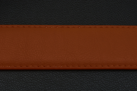 center position: brown stripe on black background. Belt from skin or leather. Belt with brown color. Center position on background. Place for your text