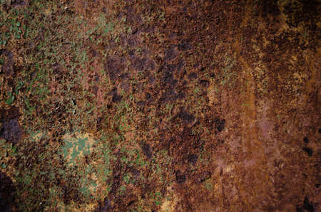 Rusted and oxidized metal texture. Background of the old ferrum sheet. Grunge wall with streaks of pitting. Concept of abstract corroded iron. Place for text.
