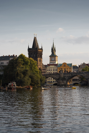 Prague's historical center, photo from the river. Embankment and the building of the European city
