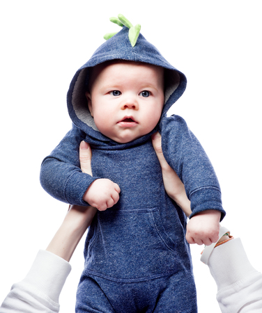 Baby in blue hoodie lifted up. A handsome boy with blue eyes. Isolated on white background