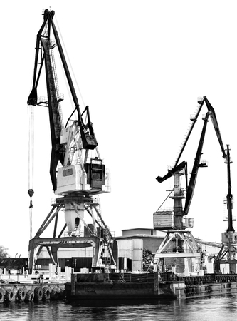 The old unloading cranes at the port. Contrasting black-and-white photo Editorial