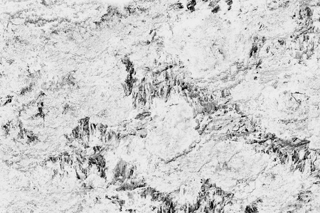 Abstract black and white background. A nonuniform textured surface 写真素材