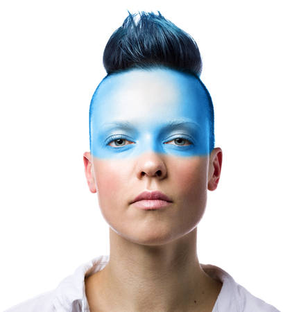 Conceptual portrait of a young woman with blue makeup. Isolated on white background