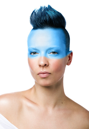 Conceptual makeup. Portrait of a young woman isolated on white background. Short blue hair, unused hairstyle