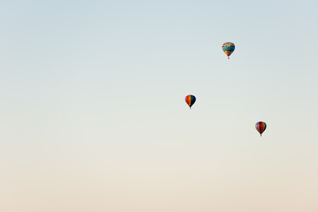 Flying in a balloon. Three objects in the air against the cloudless sky Reklamní fotografie