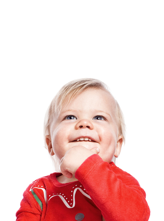 The child looks up dreamily. Waiting for Christmas. Think of gifts. One isolated on white background with free space.