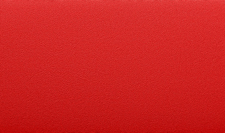 Fine texture of natural animal skin. Saturated red color. Expensive finish products. Luxury background