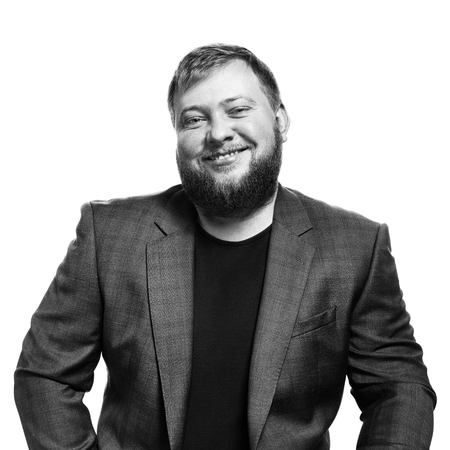 Close-up black and white portrait of a bearded man. Happy boss. Blue jacket in business look. Isolated on white background
