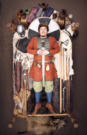 Viking Burial. Historical reconstruction of the customs of the ancient people. Warrior with his wealth Reklamní fotografie