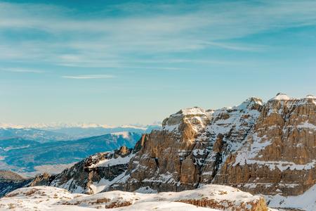 Mountain winter landscape. Snow Alps and rocks. Blue sky Reklamní fotografie