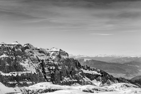 Black and white mountain winter landscape. Snow Alps and rocks
