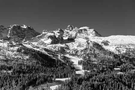 Winter Alpine landscape. Snow and mountain peaks. Ski slopes and forest Reklamní fotografie