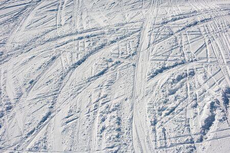 Lots of ski tracks in the snow. Skiing on the ski slope