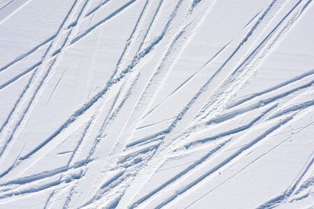Ski tracks in the fresh snow. Natural background with lines