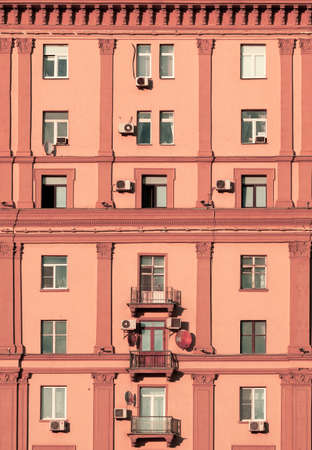 The facade of the building is in a classic style with air conditioning units Reklamní fotografie
