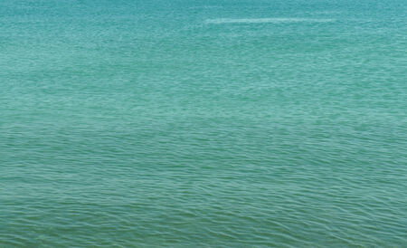 green sea: Green sea water surface
