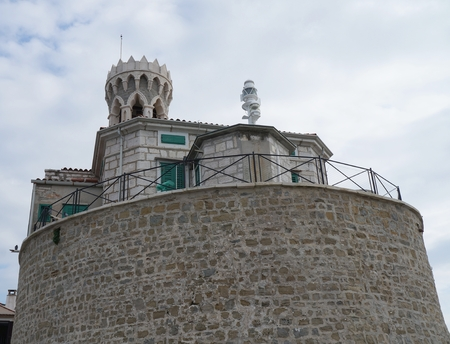 clement: the Church of St. Clement and a lighthouse in Piran