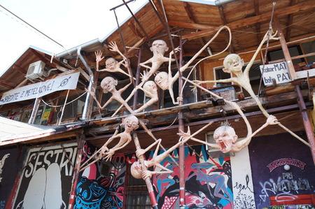 marginal: Graffitti, sculpture and mosaics on a wall in squat located in Metelkova street in Ljubljana, Slovenia