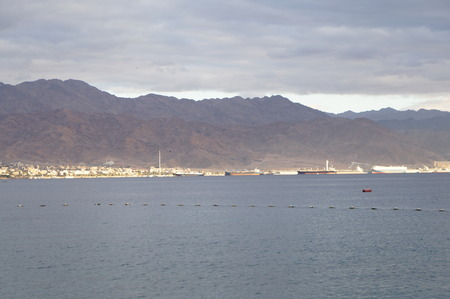 Eilat gulf and Aqaba seen from Eilat against sunlight photo