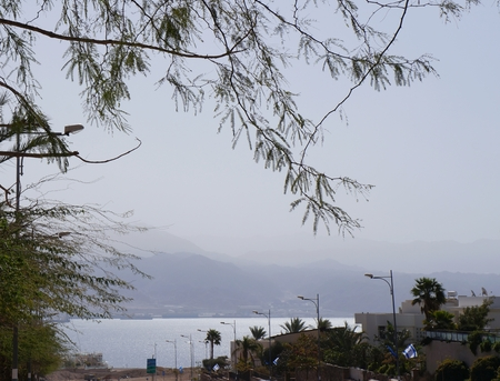 View to the Eilat gulf and Aqaba from wadi Shahamon, Eilat, Israel, the water is glittering photo