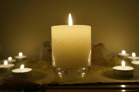 wiccan: Candles on altar, selective focus on the candle