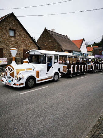 Tourist bus runs at Tihany on the road
