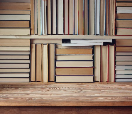 folio: Empty wooden table against the background of the bookshelves. Choice for Your object. Library, education. Back to school.