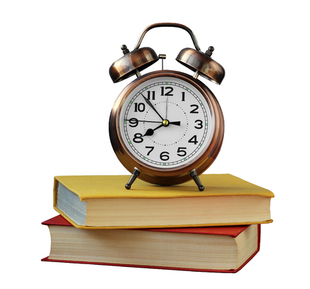 retro alarm clock and books isolated on white . Stock Photo
