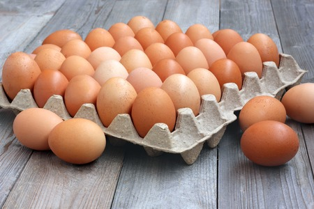 fresh chicken brown eggs in packing, a close up. food. top view.