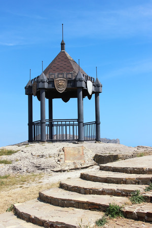 sudak: The steps leading to the gazebo on a cliff in the town of Sudak on a summer sky background.