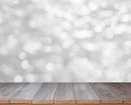 Wood table top on shiny white bokeh abstract background - can be used for display or montage your products.