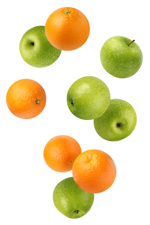 Flying (falling) green apples and oranges, isolated on white background. The whole fruit. Фото со стока