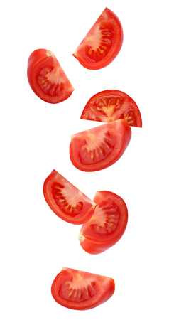 Falling (flying) red tomato,  isolated on white background. Pieces (slices) of vegetables. Stok Fotoğraf
