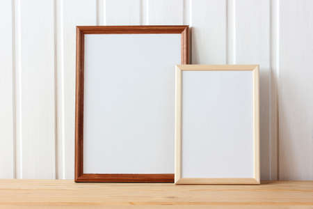 two empty wooden frames on the table. space to represent your design. mockup, scene creator.