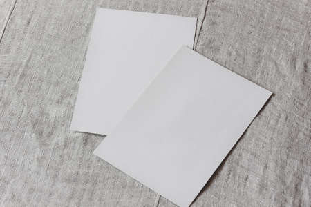 two blank sheets of paper on the table. space to represent your design. mockup, scene creator. Stock Photo