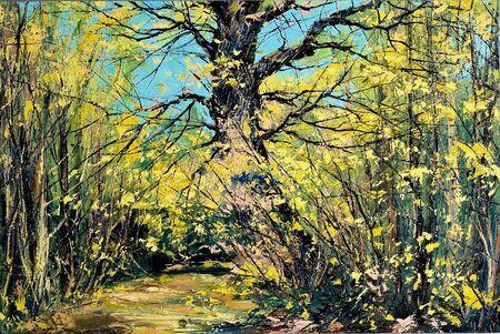 Old oak in an autumn wood photo