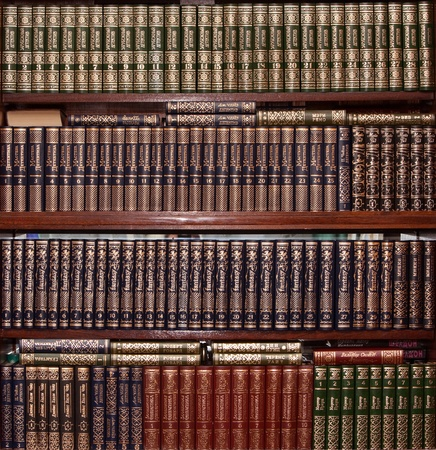 Books in gold cover in library photo