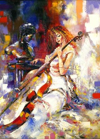 The girl plays a violoncello Фото со стока