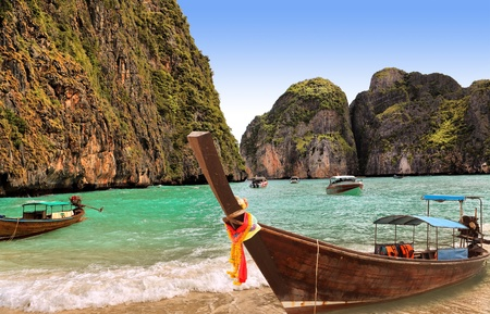 Traditional Thai boat on island Phi-phi, Thailand photo