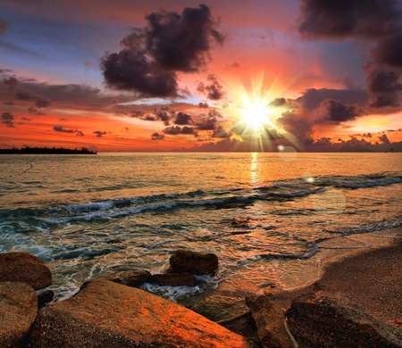 Tropical sunset on the beach photo