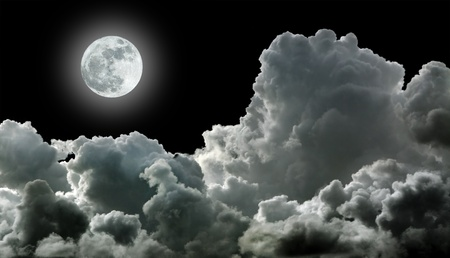 Moon in black stormy clouds photo