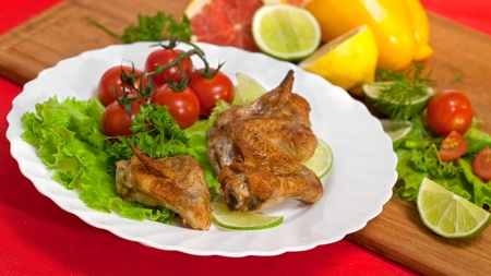 Roast chicken with salad and tomatoes photo