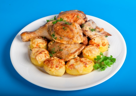 roast chicken with potatoes and greens photo