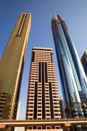 taller: DUBAI, UAE - OCTOBER 23: View at Sheikh Zayed Road skyscrapers in Dubai on October 23, 2012. More than 25 skyscrapers taller than 100 meters can be found here.