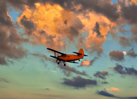 sunsets: small plane against the sky on a decline