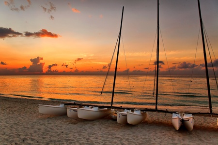 catamarans on Varaderos beach at sunset, Cuba photo